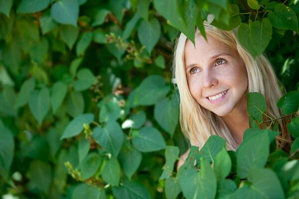 Beautiful female portrait around nature and smiling